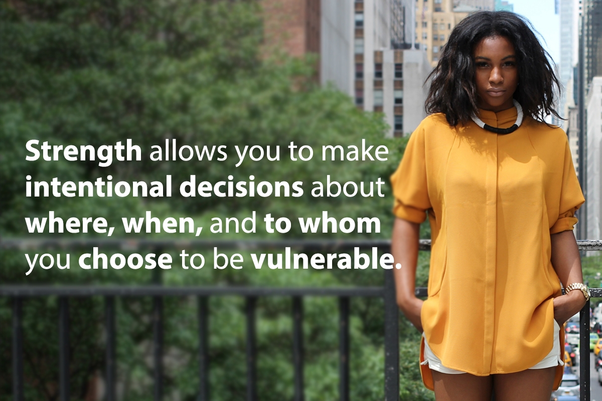 Strenght allows you to make intentional decisions about where, when, and to whom you choose to be vulnerable. Woman in a yellow shirt looking bold and intense.